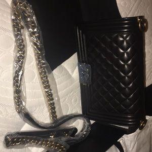 Handbags - Black and gold Chanel boybag